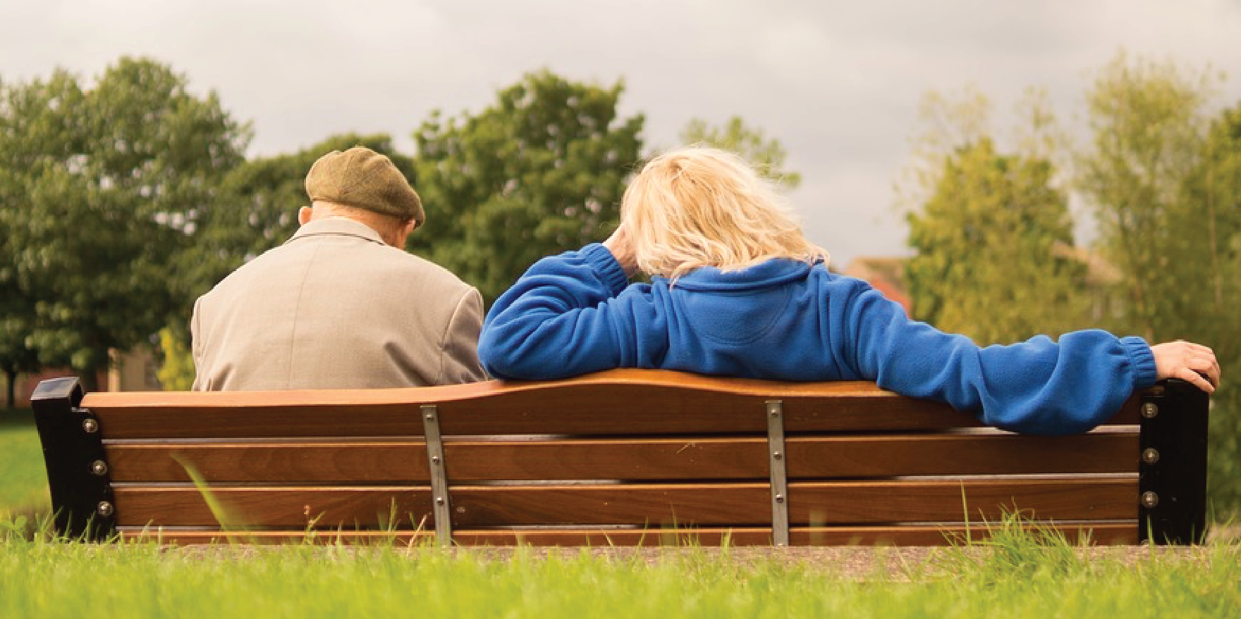 Couple Resting on Bench